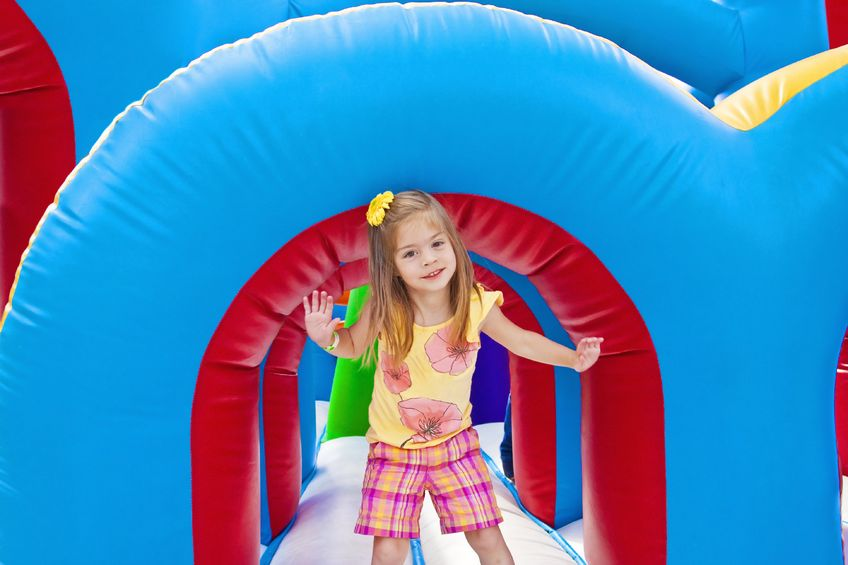 Girl playing on an inflatable ride at her school carnival!