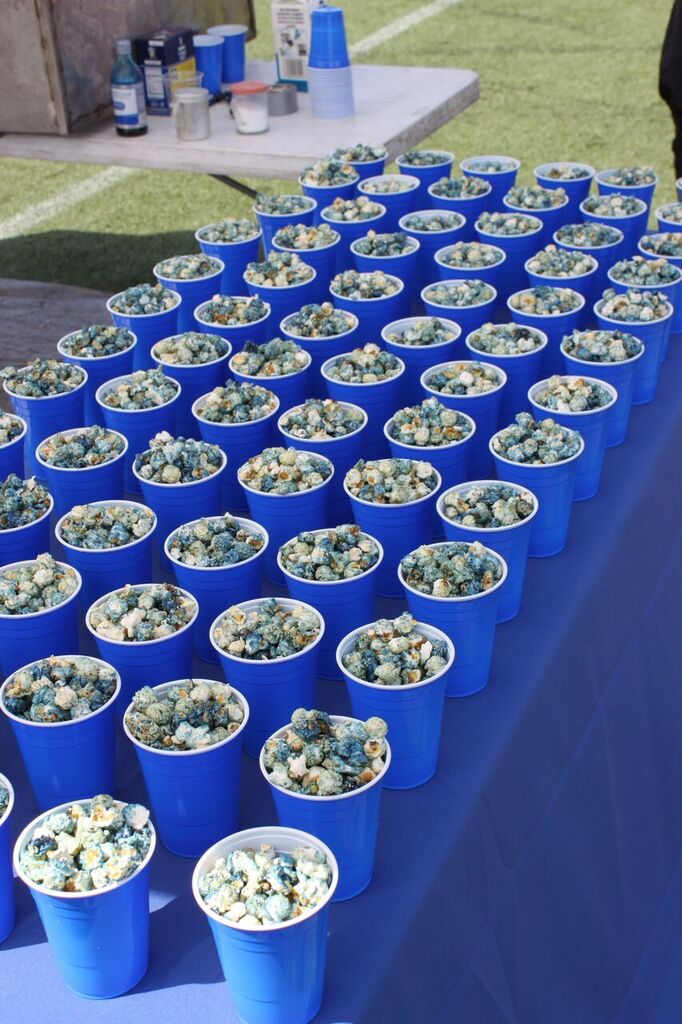 """Blue popcorn in blue cups at the ship party for Microsoft's """"Blue"""" mobile operating system."""