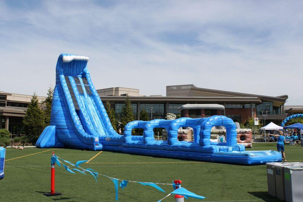 100′ Long Blue Crush Xtreme Water Slide rental at a summer company picnic