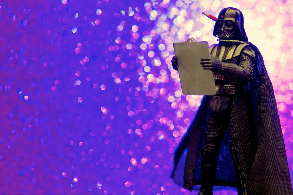 Darth Vader holding a clipboard and pencil