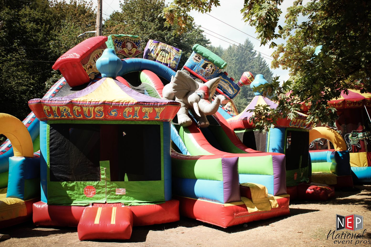 23′ Circus City Triple Lane Slide w/ Bouncers