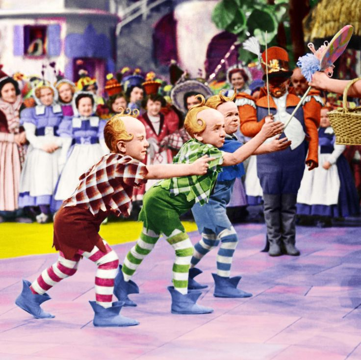Munchkins presenting a lollipop in The Wizard of Oz
