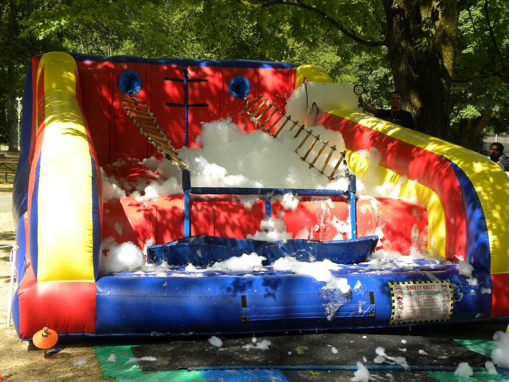 Jacob's Ladder inflatable rope ladder climbing challenge over a soap bubble foam pit