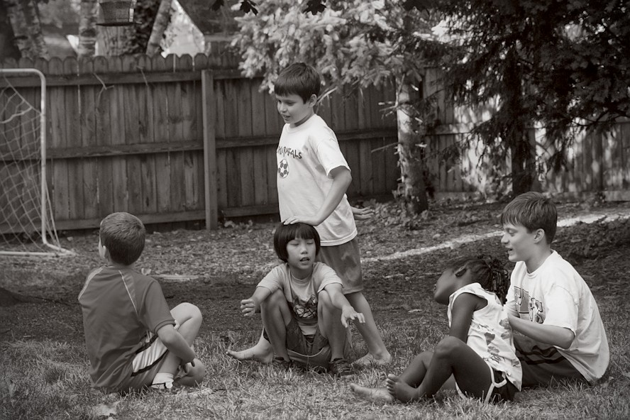 kids playing duck duck goose