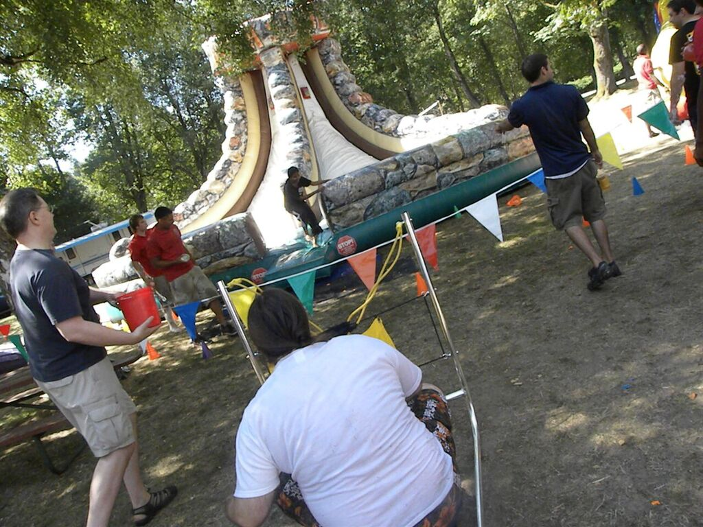 water balloon launcher and warped wall challenge at a summer company picnic