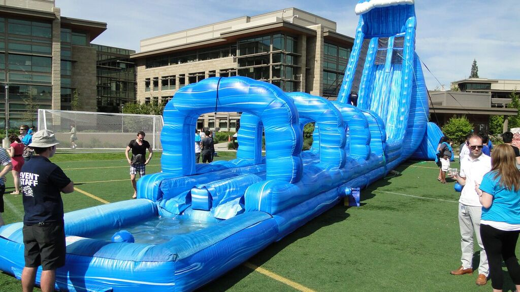 100′ Long Blue Crush Xtreme Water Slide rental at a summer company party