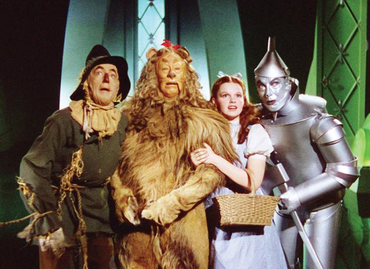 Scarecrow, Cowardly Lion, Dorothy, and Tin Man in The Wizard of Oz