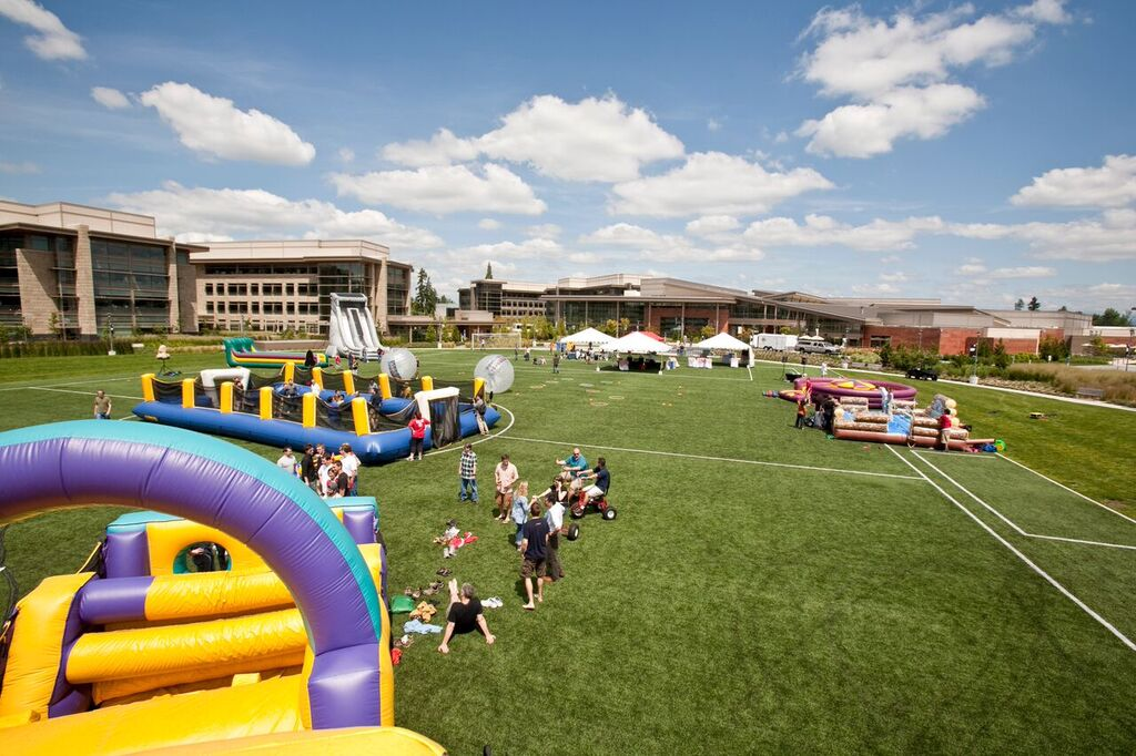 inflatable games at a summer company picnic