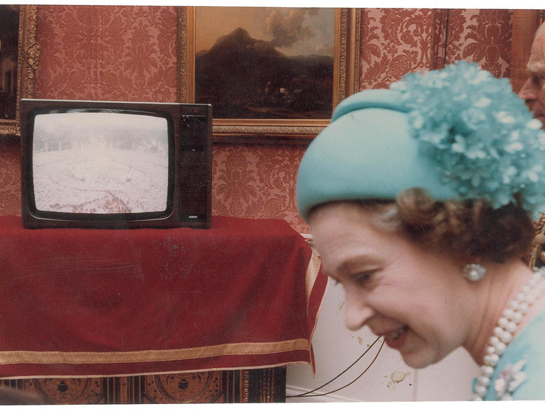 Queen Elizabeth II watching the wedding of Princess Diana and Prince Charles on TV