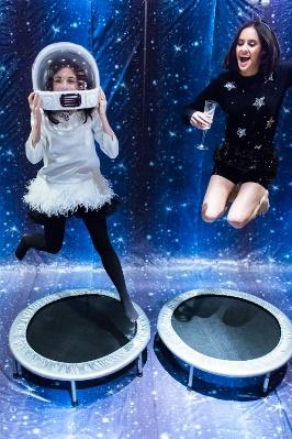 jumping on trampolines in a stargazing room