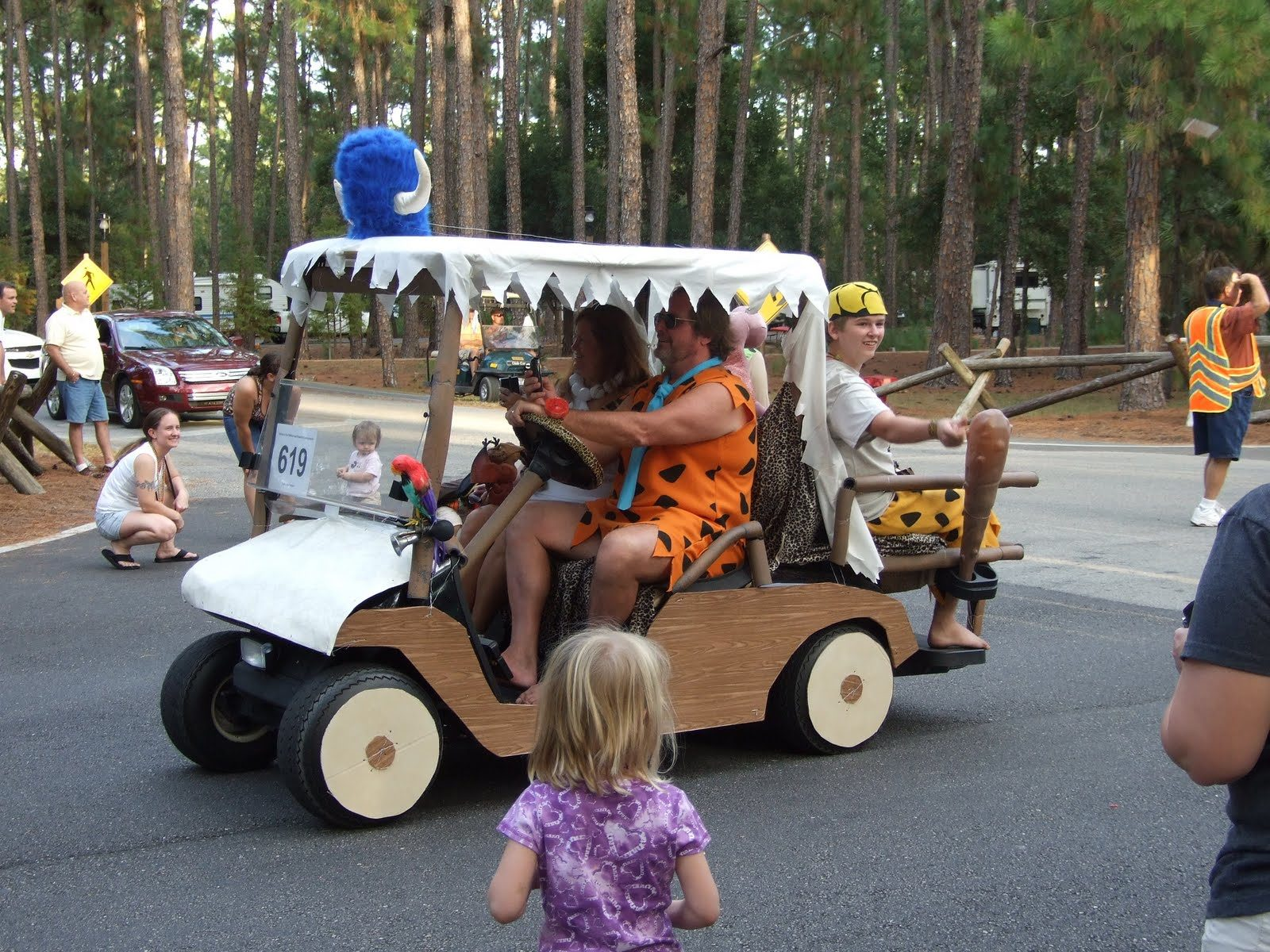 golf cart decorated as The Flintstones car