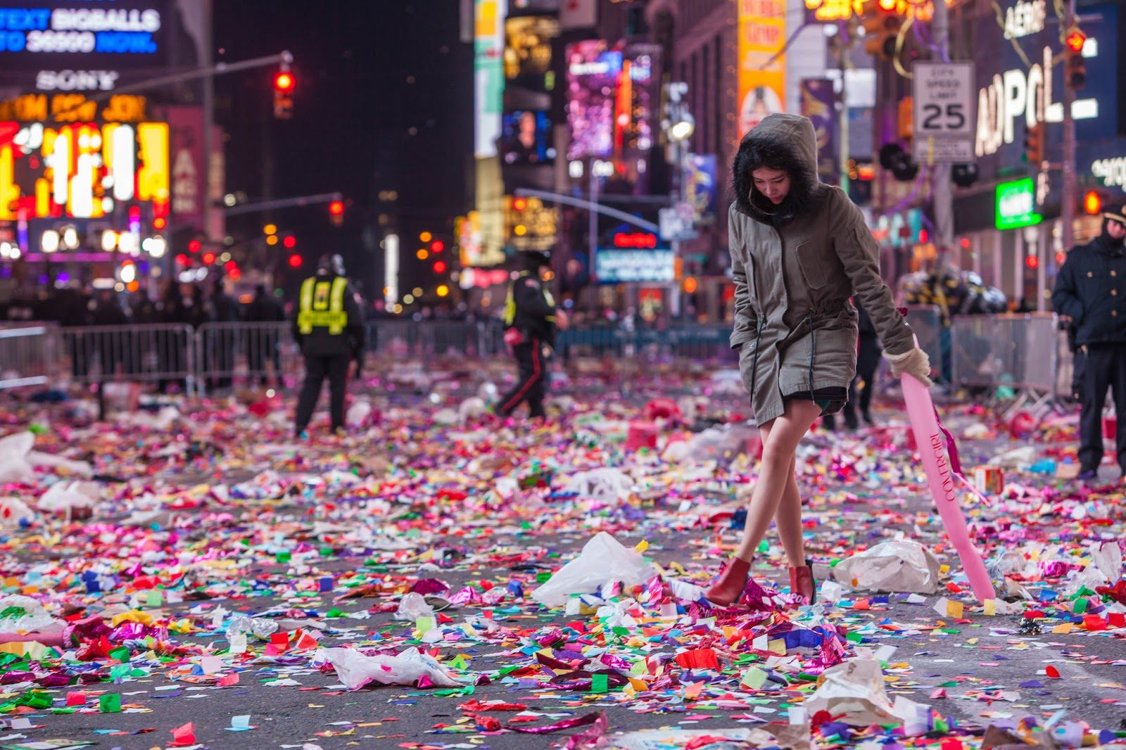 Girl walking through times square confetti