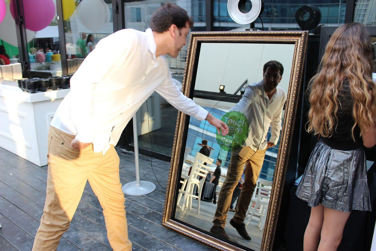 man touching mirror