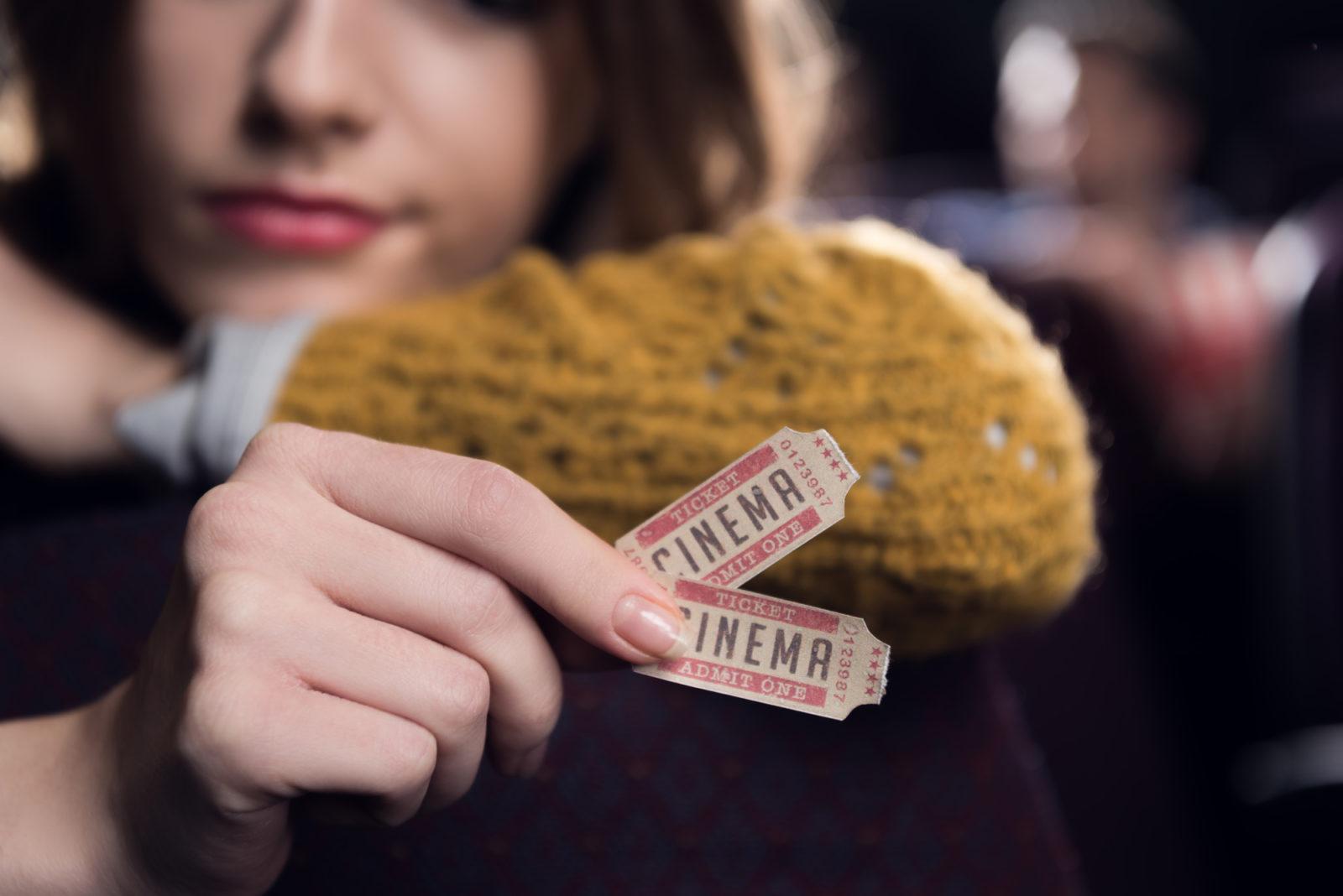 women holding tickets
